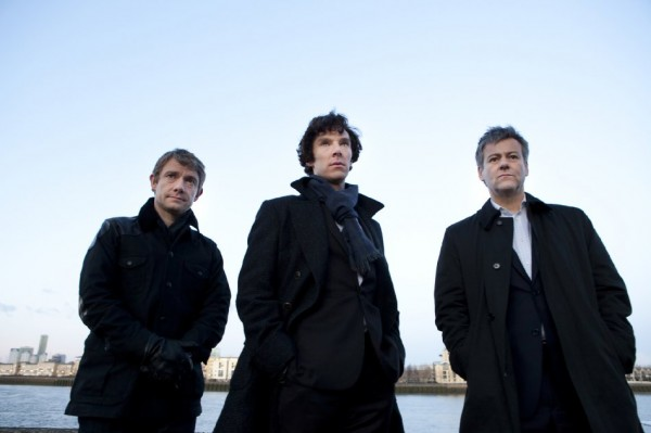 Martin Freeman as John Watson, Benedict Cumberbatch as Sherlock Holmes and Rupert Graves as D.I. Lestrade looking solemnly at something off camera