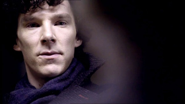 Benedict Cumberbatch as BBC Sherlock looking serious and arrogant as someone
