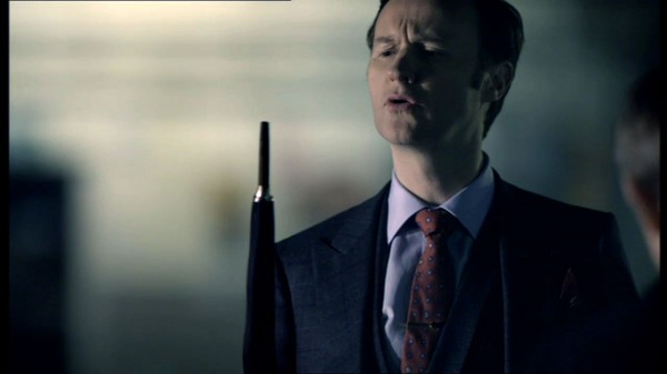 Mark Gatiss as Mycroft Holmes in BBC Sherlock looking at his umbrella tip