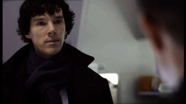Benedict Cumberbatch as Sherlock Holmes in BBC series Sherlock staring at Martin Freeman as John Watson
