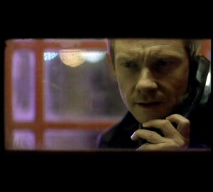 Martin Freeman as John Watson in the BBC series Sherlock on the phone in a phone box