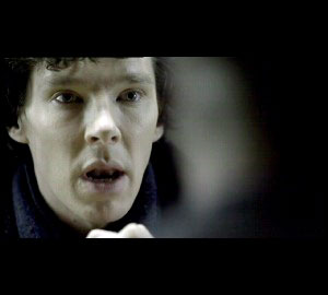 Benedict Cumberbatch as Sherlock at a moment of insight on the BBC series Sherlock