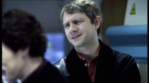 Martin Freeman as Dr. John Watson in BBC Sherlock looking skeptical.