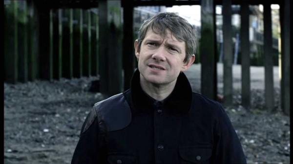 Martin Freeman as Dr. John Watson looking at the sky with a perplexed expression