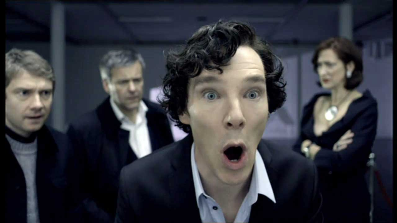 "Benedict Cumberbatch as Sherlock Holmes with a big surprised ""oh!"" look on his face"