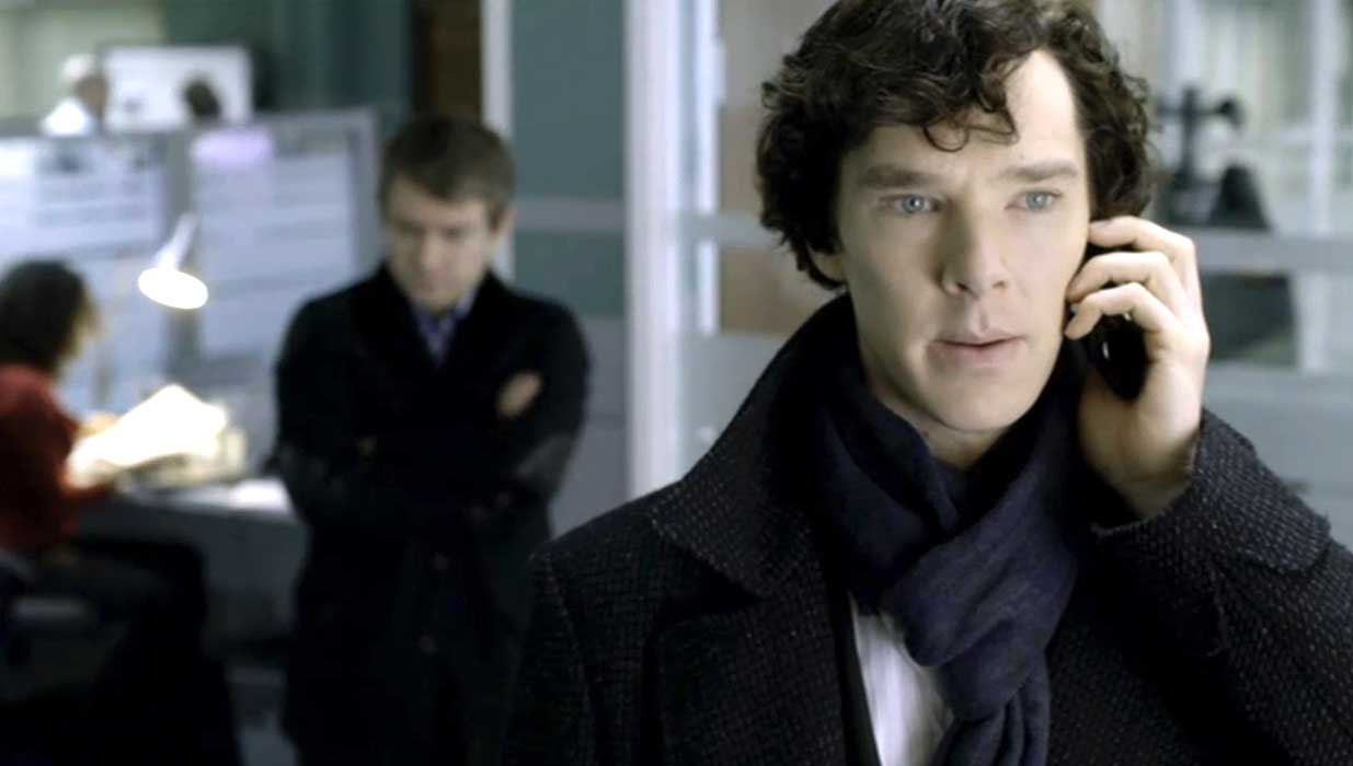 Benedict Cumberbatch as BBC Sherlock looking alarmed as he listens to a mobile call