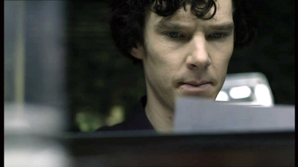 Benedict Cumberbatch as BBC Sherlock Holmes reading a piece of paper