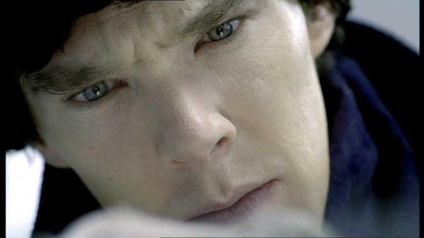 Extreme close up of Benedict Cumberbatch as Sherlock Holmes in the BBC series Sherlock looking at something white and pasty