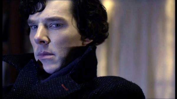 Close-up of Benedict Cumberbatch as BBC Sherlock in black coat looking displeased