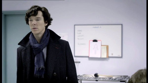 Benedict Cumberbatch as BBC Sherlock looking at something off camera with decided interest