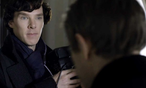Benedict Cumberbatch as BBC Sherlock Holmes looking miffed and slightly threatening with a camera flash unit