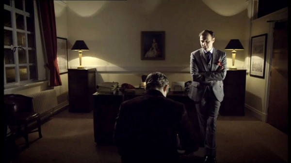 Mark Gatiss as Mycroft Holmes in BBC Sherlock talking with Martin Freeman as John Watson