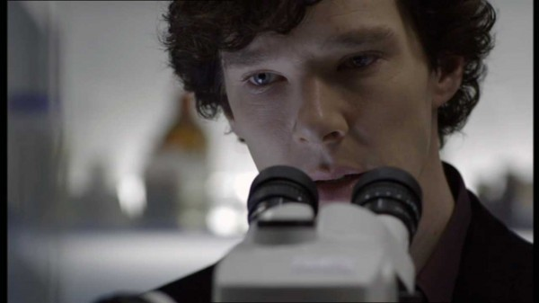 Benedict Cumberbatch as BBC's Sherlock Holmes looking up from a microscope