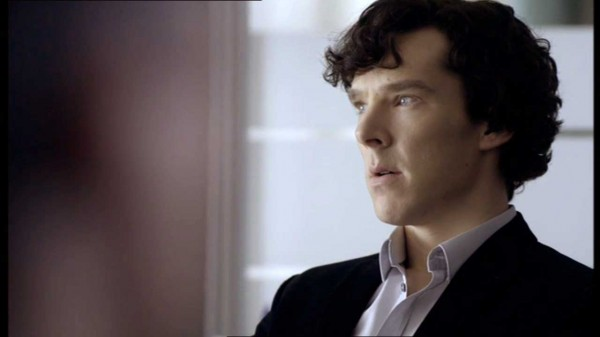 Benedict Cumberbatch as Sherlock Homes in the BBC series Sherlock sitting, looking deep in thought