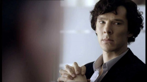 Benedict Cumberbatch as Sherlock Holmes in the BBC series Sherlock looking skeptically at someone off camera
