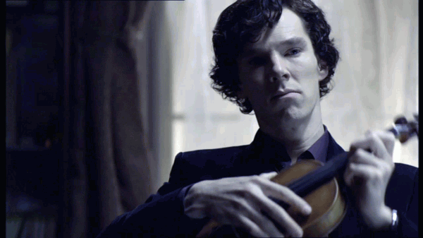 Benedict Cumberbatch as BBC Sherlock Holmes holding violin and looking sad while wearing purple shirt