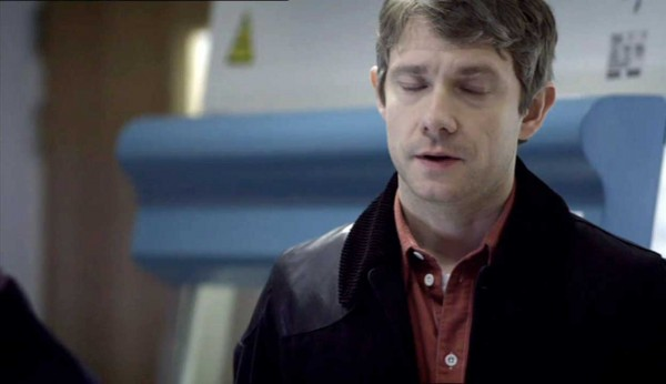Martin Freeman as Dr. John Watson on BBC series Sherlock standing with eyes closed in exasperation