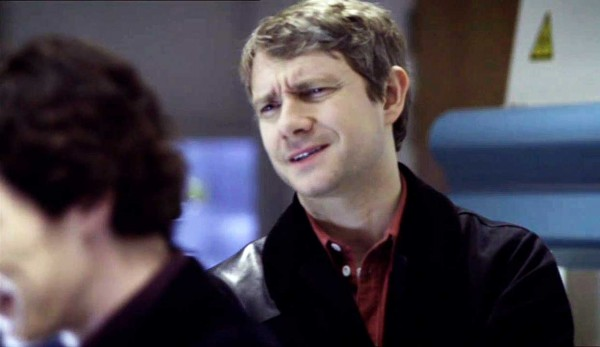 Martin Freeman as John Watson in BBS series Sherlock givng a look of disbelief at Sherlock Holmes
