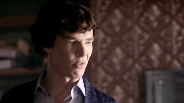 Benedict Cumberbatch as Sherlock Holmes with a stupid expression and a questioning look