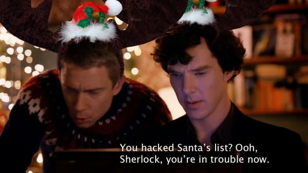 Benedict Cumbertach  as BBC Sherlock Holmes with Martin Freeman as John Watson in antlers - Text says: You hacked Santa's list? Ooh, sherlock, you're in trouble now.