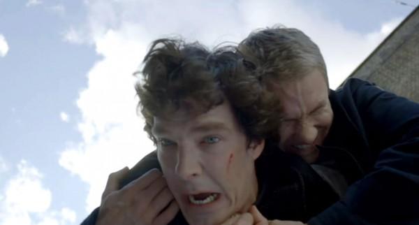 Benedict Cumberbatch as Sherlock Holmes and Martin Freeman as John Watson in  BBC Sherlock grabbling