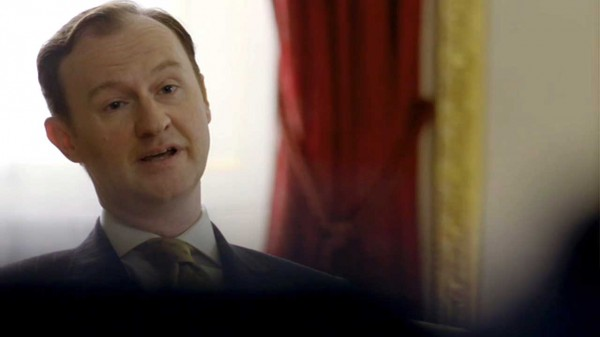 Actor, Writer and co-creator of the BBC series Sherlock, Mark Gatiss as Mycroft Holmes sitting in Buckingham Palace