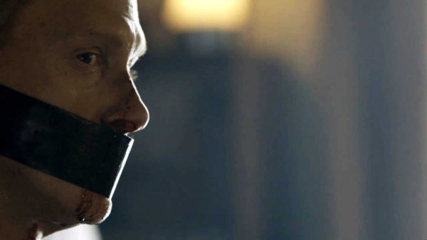 From BBC series Sherlock - close up of man with duct tape over his mouth