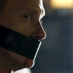 CIA Agent in BBc Sherlock A Scandal in Belgravia with mouth taped shut