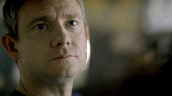 Martin Freeman as BBC Sherlock John Watson looking serious and hurt