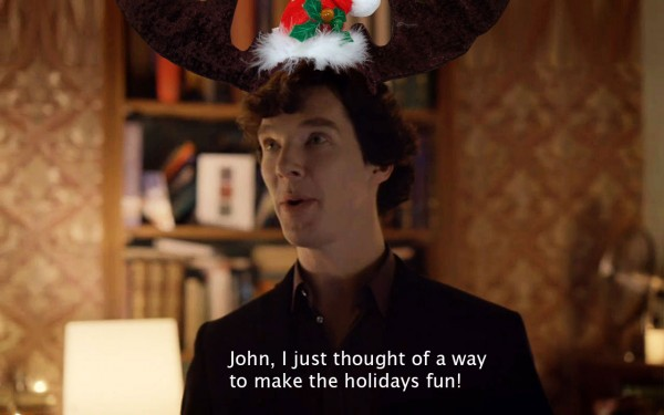 Benedict Cumberbatch as BBC Sherlock Holmes looking excited during the holidays -- in an antler hat