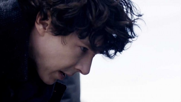 Close-up Benedict Cumberbatch as BBC Sherlock Holmes bending over and staring at something