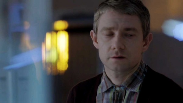 Martin Freeman as John Watson in the BBC Series Sherlock looking dopey with psychedelic-looking lights and colors out of focus around him