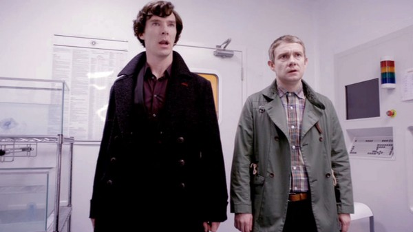 Benedict Cumberbatch as BBC Sherlock and Martin Freeman as John Watson appear stunned and astounded standing in a lab