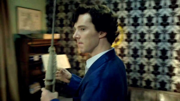 Benedict Cumberbatch as BBC Sherlock holding a harpoon and looking peeved
