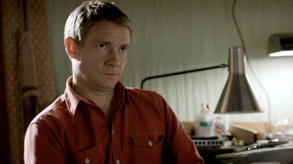 Martin Freeman as John Watson in BBC Sherlock looking decidedly unhappy with someone off camera