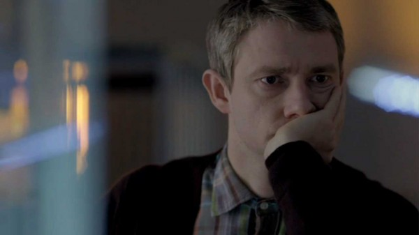 Martin Freeman as John Watson in the BBC series Sherlock sitting in thought with his head resting on his hand