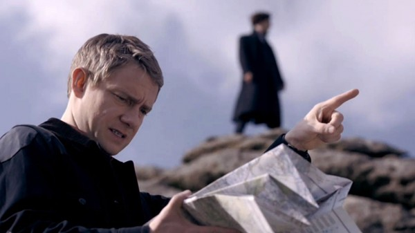 Martin Freeman as BBC Sherlock John Watson pointing while reading map with Benedict Cumberbatch as Sherlock in the background