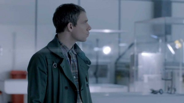 Martin Freeman as John Watson appearing to be whistling in a laboratory