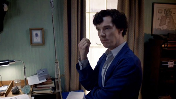Benedict Cumberbatch as BBC Sherlock Holmes in his blue bathrobe looking thoughtful