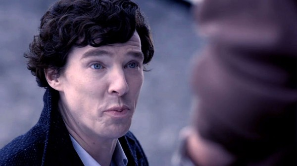 Benedict Cumberbatch as BBC Sherlock Holmes making a funny puckered lips face