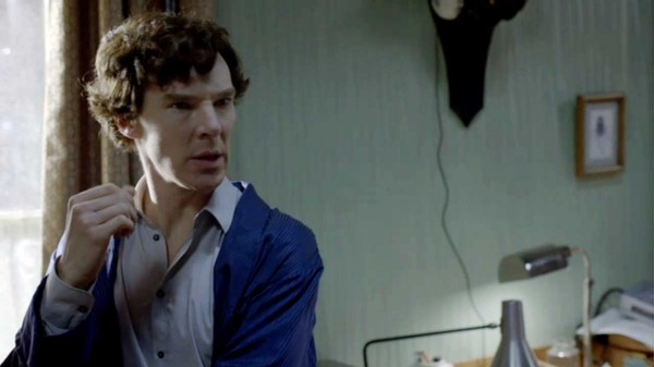 Benedict Cumberbatch as BBC Sherlock Holmes in his blue dressing gown looking puzzled