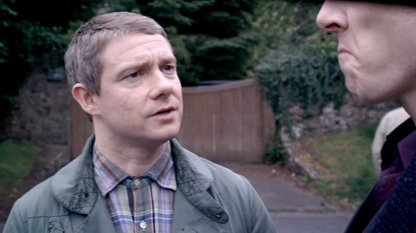 Martin Freeman as John Watson in BBC Sherlock talking to a frowning Benedict Cumberbatch as Sherlock Holmes
