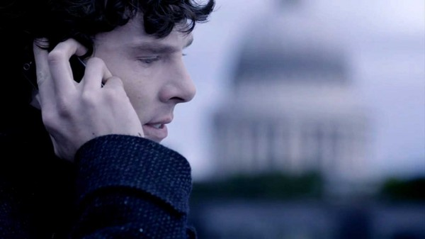 Close Up Benedict Cumberbatch as BBC Sherlock on Bart's Roof with mobile cell phone