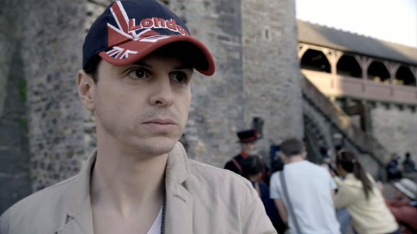 Andrew Scott as James Moriarty in BBC Sherlock in a London ballcap and casual clothes