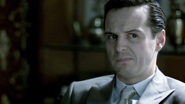 Andrew Scott as James Moriarty in BBC Sherlock looking disgruntled