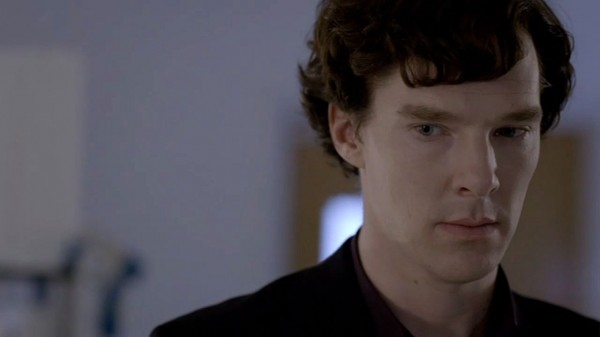 Benedict Cumberbatch as BBC Sherlock Holmes looking thoughtful in balck suit and shirt