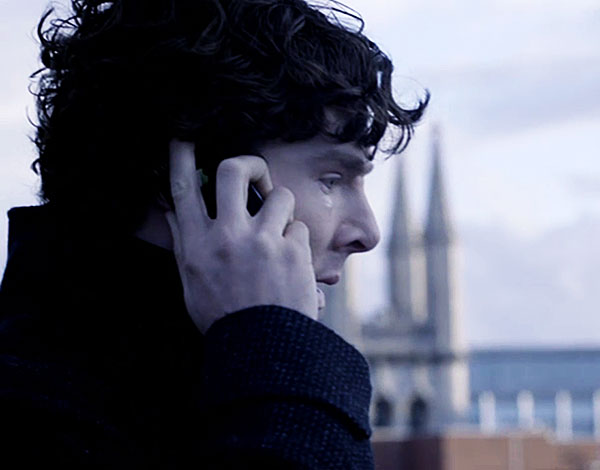 Benedict Cumberbatch as BBC Sherlock Holmes crying on Bart's rooftop in Reichenbach Falls