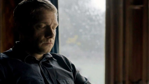 Martin FReeman as Dr. John Watson sitting with his eyes closed