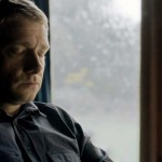 Martin Freeman as Dr. John Watson in BBC series Sherlock sitting with eyes closed