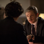 Martin Freeman as John Watson in BBC Sherlock with mustache talking to Benedict Cumberbatch as Sherlock